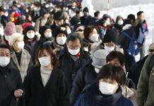 Mundschutz bereitete Japanern wegen warmen Wetter Sorgen